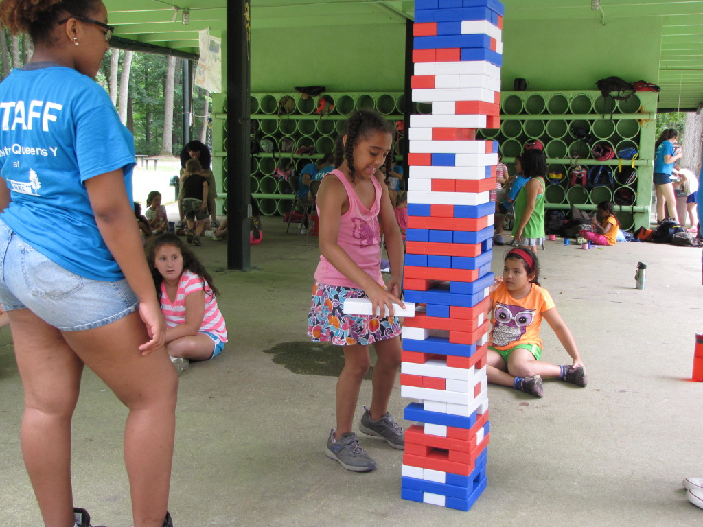 Playing  giant Jenga is surely a challenge at the Central Queens Y Day Camp.