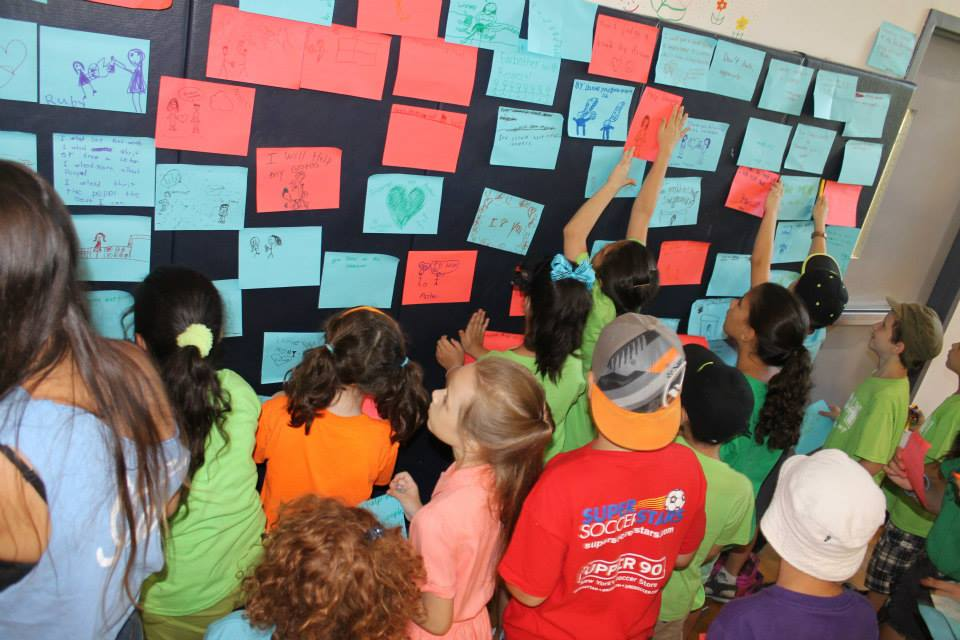 Campers write and post their ideas about spreading loving kindness throughout camp.
