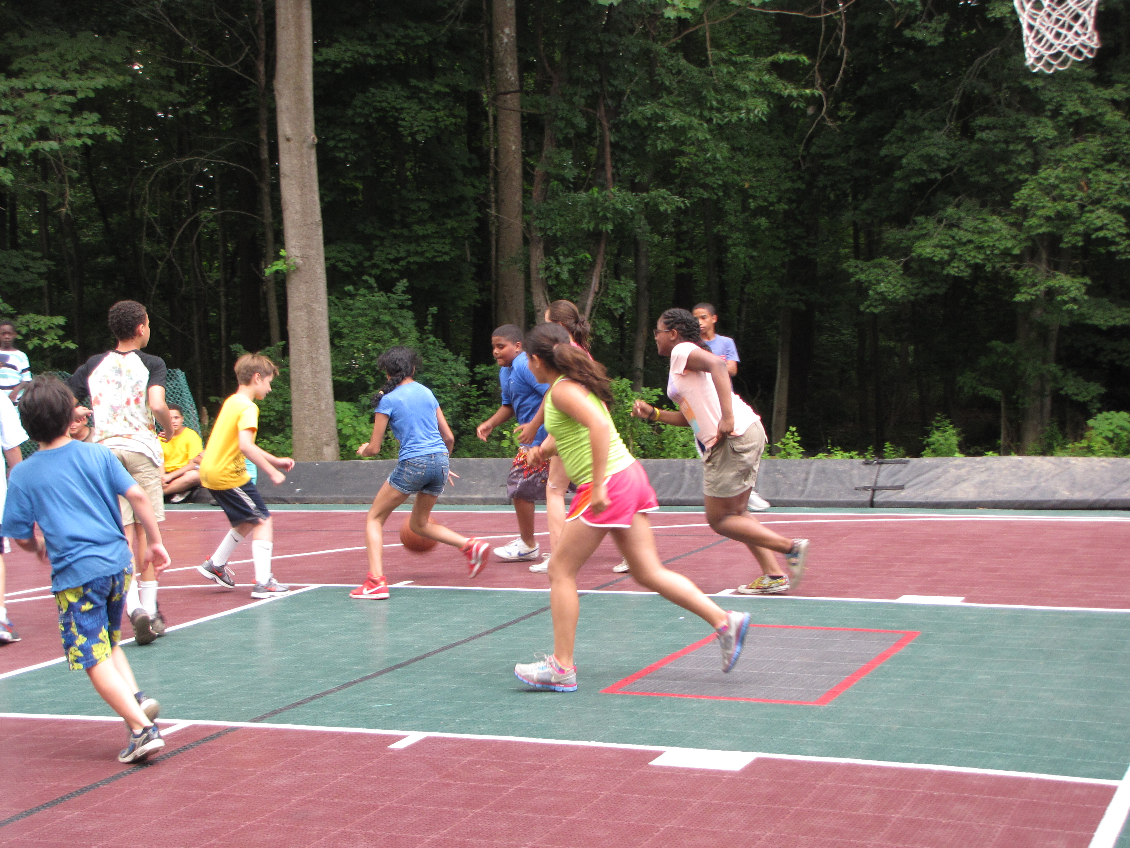 A great game of basketball on the multi-sport court.