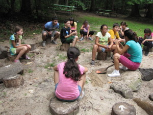 Campers learn about pollination before the work in the bean garden.