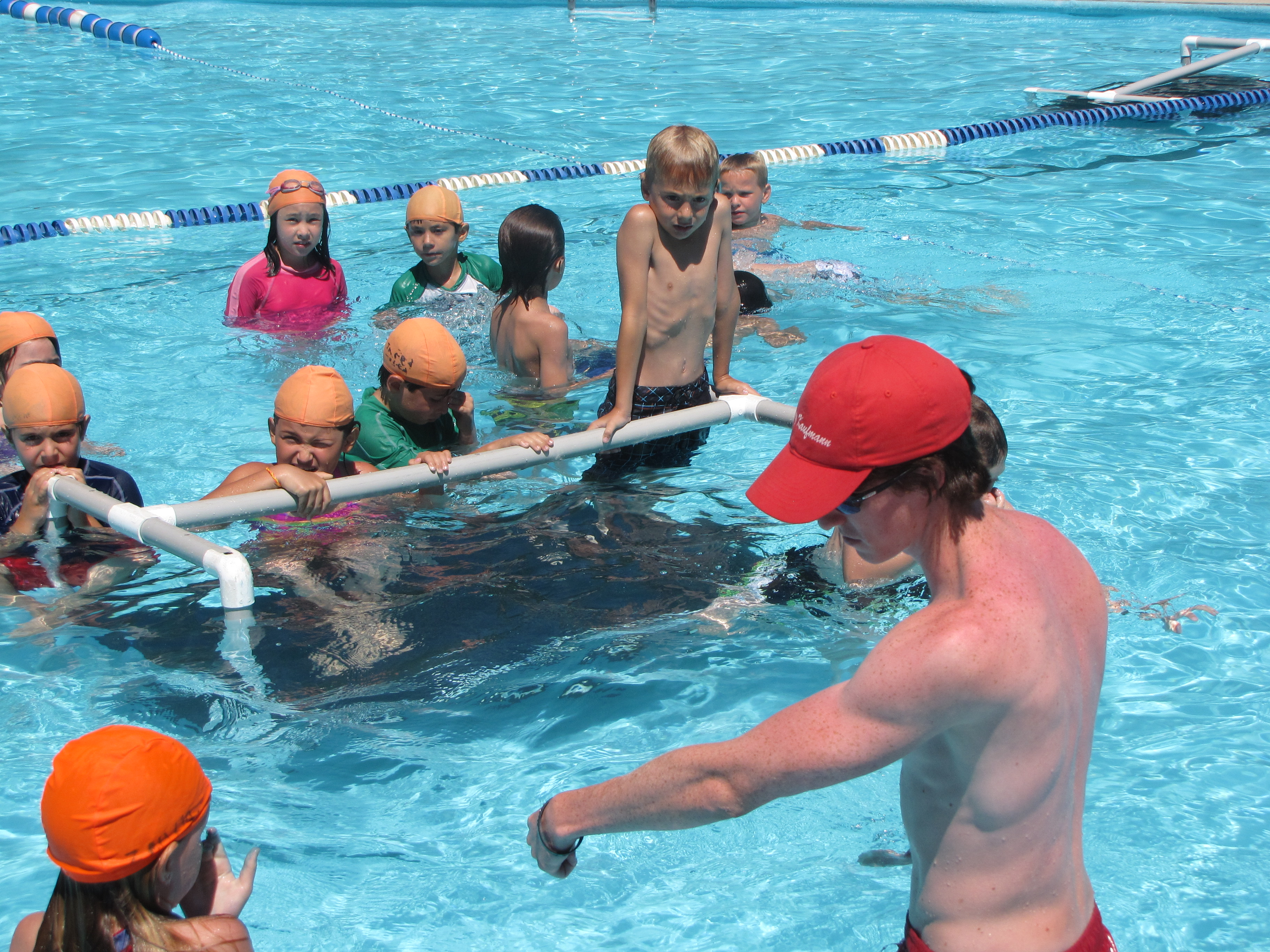 A pool platform helps campers learn to swim.