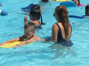 Kick boards help campers learn to swim.