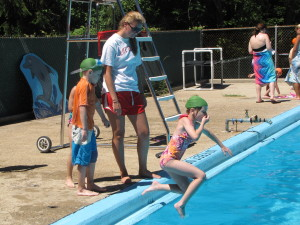 Learning to jump off the side of the pool is fun.