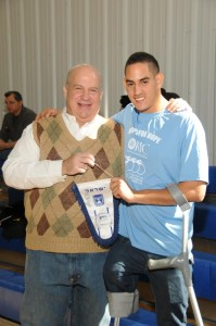 Asael presenting a flag to our CEO, Lenny Silberman.